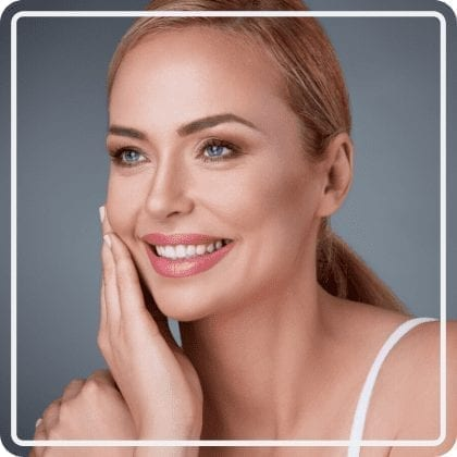 Model head shot with hand on face - New Image Med Spa